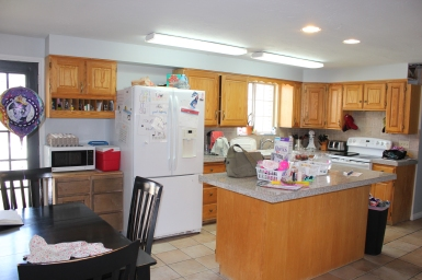 Before: Kitchen with homeschooling space