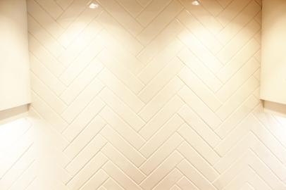 Herringbone pattern tiled backsplash in Clinton, Utah