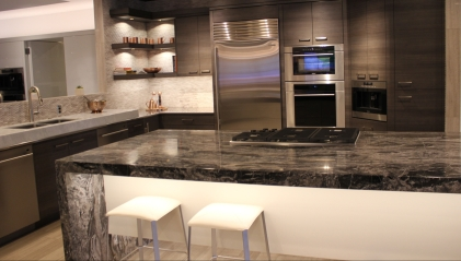 Sample lighting under cabinets, highlighting shelves and beneath the island counter top.