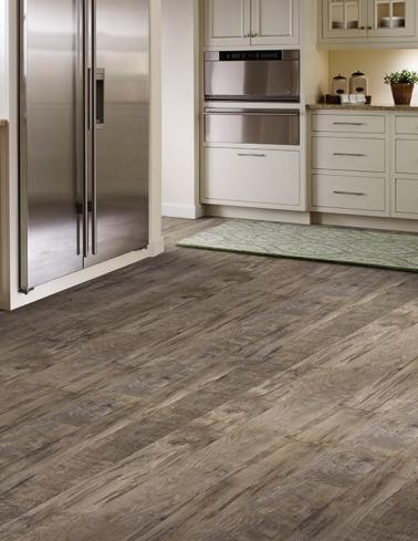 Kitchen with vinyl flooring that looks like a hardwood, plank floor.
