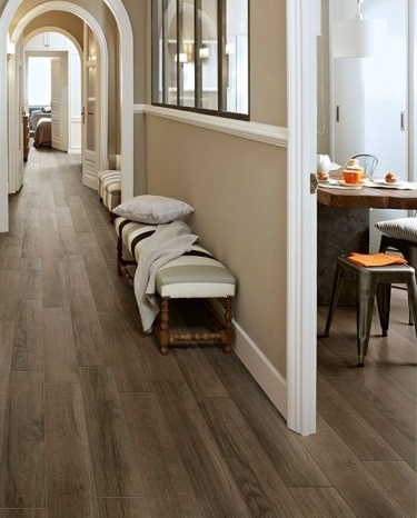 Residential interior with flooring that looks like hardwood but is made of rubber.