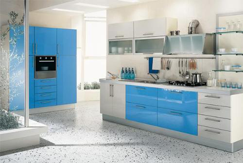 Turquoise and white kitchen with terrazzo floor.