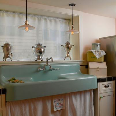 Retro, cast iron sink with faucet and sideboards.