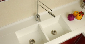 Duel tub, solid surface sink with modern faucet.