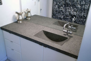 Curved basin, solid surface sink.