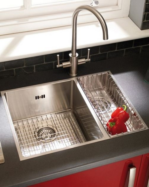 Smaller, shallow tub with large tub stainless steel sink.