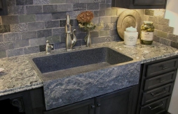 Deep tub, stone sink with apron top mounted.