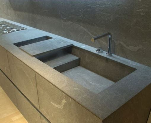 Contemporary, stone sink with multi-level basin.